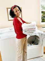 Woman holding folded launcdry